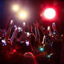 Crowd holding up cell phones